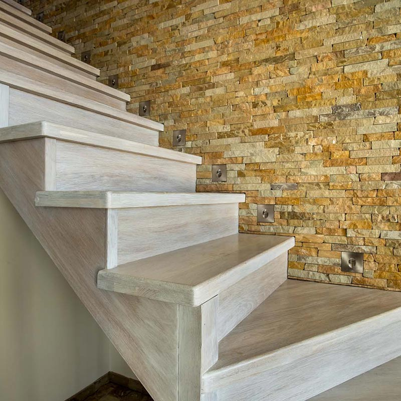 tiled rock wall staircase